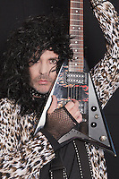 Portrait of middle-aged man wearing leopard skin pattern with electric guitar