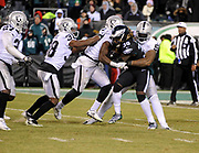 Dec 25, 2017; Philadelphia, PA, USA; Oakland Raiders linebacker Bruce Irvin (51) makes a stop of Eagles running back Jay Ajayi (36) during a NFL football game at Lincoln Financial Field. The Eagles defeated the Raiders 19-10. Photo by Reuben Canales