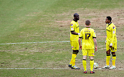 COLCHESTER, ENGLAND - Saturday, February 23, 2013: Tranmere Rovers' Mamady Sidibe, Max Power and Jean-Louis Akpa Akpro look dejected as Colchester United score their first goal during the Football League One match at the Colchester Community Stadium. (Pic by Vegard Grott/Propaganda)