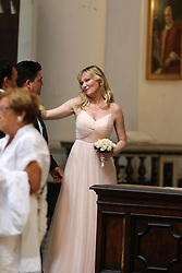 EXCLUSIVE: ***NO WEB UNTIL 1PM, OCT 2*** Kirsten Dunst is a bridesmaid at the Rome wedding of her best friend, Cindy McGee, who married John Manieri, a pharmaceutical executive. Guests at the lavish wedding, from the US and some Italians, stayed in a luxury 5 star hotel, and enjoyed limousine service to a party at Villa Aurelia, overlooking Monte Mario. The wedding took place in the monumental church of Sant'Ignazio. Dunst's parents also attended the wedding. 30 Sep 2017 Pictured: Kristen Dunst,John Manieri. Photo credit: MEGA TheMegaAgency.com +1 888 505 6342