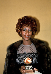 The Queen of Soul Aretha Franklin poses with the 'Best Female R&B Vocal Performance' award