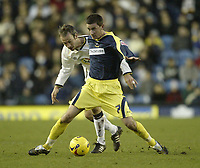 Photo: Aidan Ellis.<br /> Leeds United v Derby County. Coca Cola Championship. 09/12/2006.<br /> derby's David Jones holds off Leeds Shaun Derry