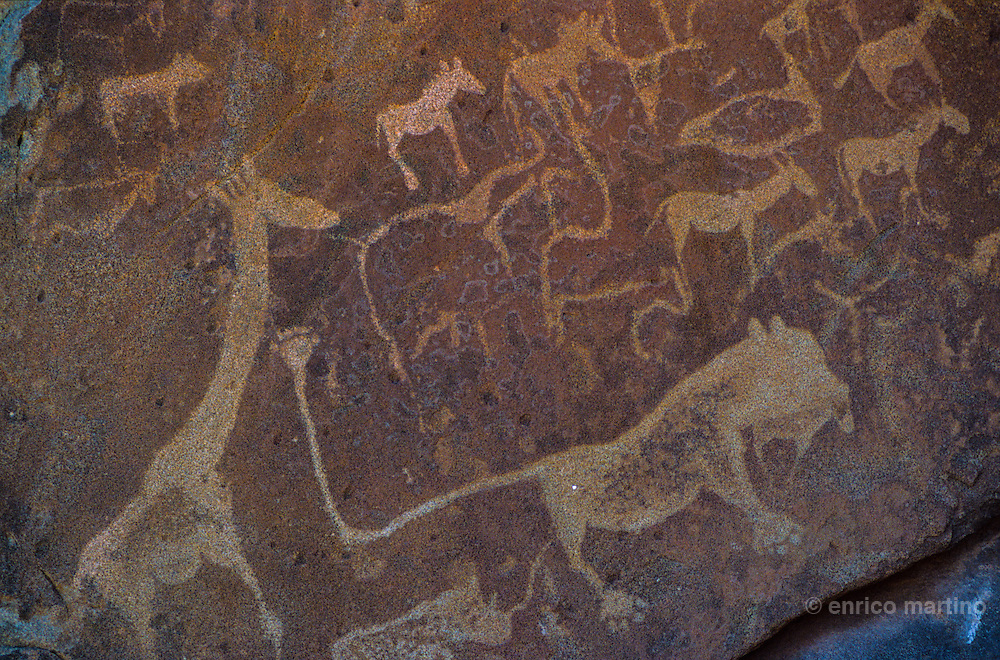 Twyfelfontein, one of the largest concentrations of rock petroglyphs in Africa. Most of these well-preserved engravings represent rhinoceros, elephant and giraffe, as well as drawings of animal footprints.