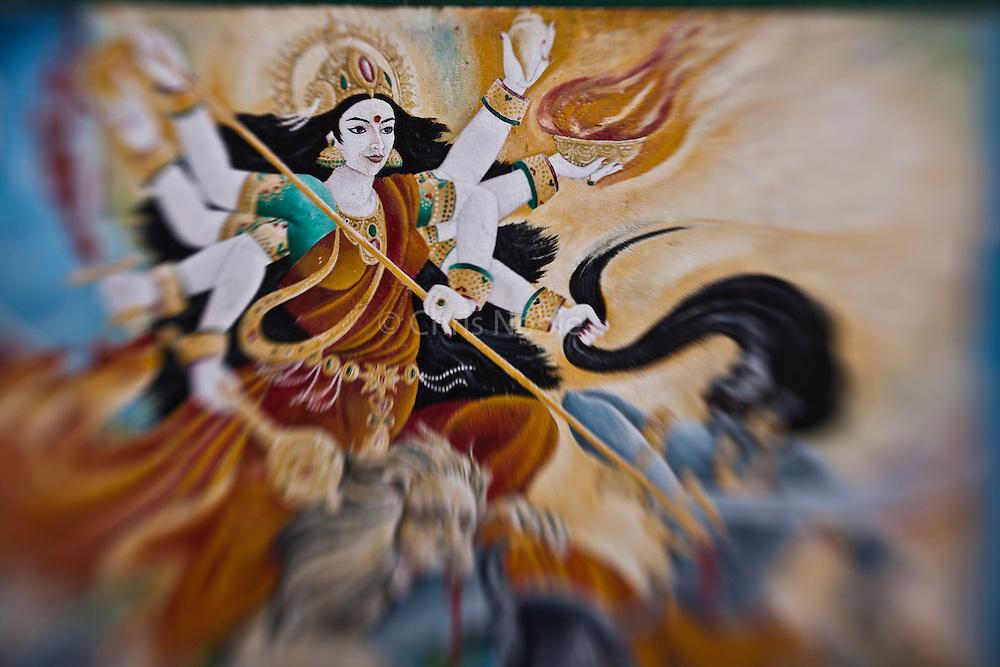 A painting of the Hindu goddess Durga adorns the walls of a temple at Kathmandu's Pashupatinath.