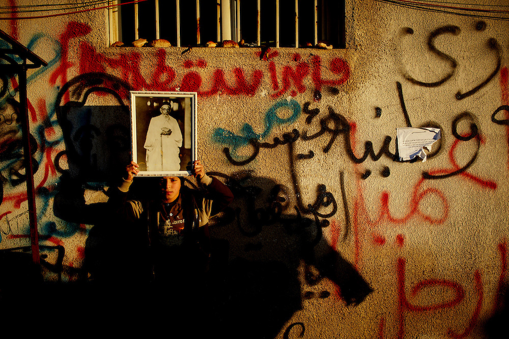 Benghazi, Libya, 28.02.11..A boy with an image of King Idris in the center of Benghazi...Photo by: Eivind H. Natvig/MOMENT