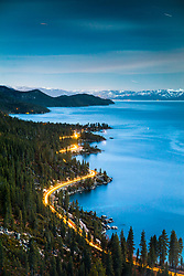 """Tahoe East Shore At Night 1"" - Photograph of the wavy shoreline along Lake Tahoe's east shore, shot at night while cars were driving along the road."
