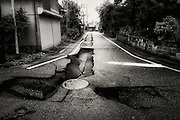 Roads are cracked and crumbled in Ojiya town in the northern province of Niigata, Japan shortly after the Chuetsu earthquake, a magnitude 6.9 quake that struck the region on October 23, 2004.