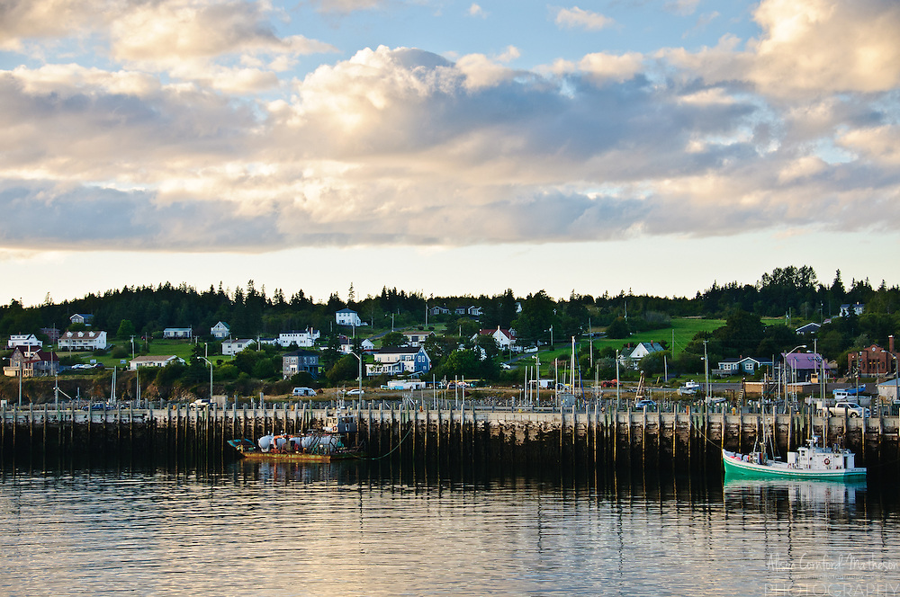 The sun sets over fishing boats in Grand Manan Island, New Brunswick, Canada