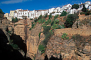 SPAIN, ANDALUSIA RONDA: beautiful 'pueblo blanco' and resort perched above the ravine (tajo) of the Guadalevin River; homes on ravine edge
