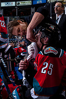 KELOWNA, CANADA - NOVEMBER 29: Kelowna Rockets' athletic therapist, Scott Hoyer, stands on the bench and stitches up a cut on the lip of Cal Foote #25 of the Kelowna Rockets on November 29, 2017 at Prospera Place in Kelowna, British Columbia, Canada.  (Photo by Marissa Baecker/Shoot the Breeze)  *** Local Caption ***