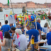 VENICE, ITALY - JULY 20:  People gather on boats of all sizes at Punta della Dogana in St. Mark's Basin for the Redentore Celebrations on July 20, 2013 in Venice, Italy. Redentore , which is in remembrance of the end of the 1577 plague, is one of Venice's most loved celebrations. Highlights of the celebration include the pontoon bridge extending across the Giudecca Canal, gatherings on boats in the St. Mark's Basin and a spectacular fireworks display.  (Photo by Marco Secchi/Getty Images)