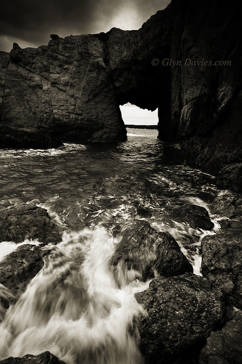 The crumbly limestone rock arch of Bwa Gwyn, Rhoscolyn Head, Anglesey.