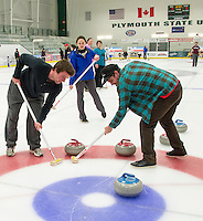 Matt Cann and Klint Skelly sweep to get their stone in the house for the Rock Blockers team during Thursday night's Curling League at Plymouth State University Ice Arena.  (Karen Bobotas/for the Laconia Daily Sun)