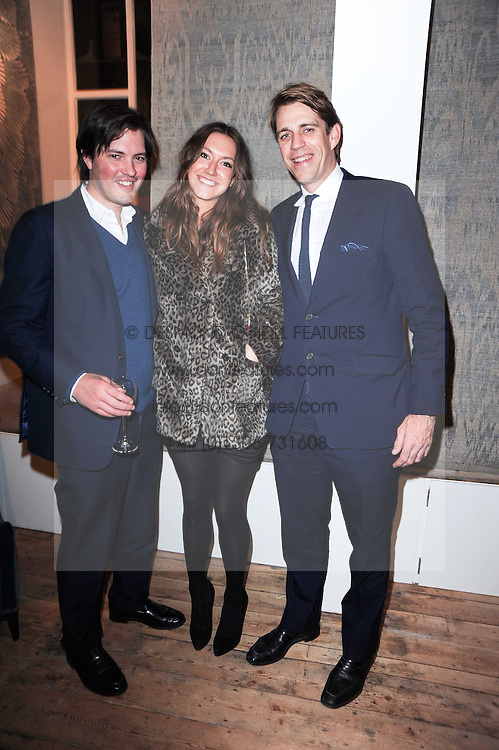 Left to right, HARRY LOPES, MARY-CLARE WINWOOD and BEN ELLIOT at the opening of Luke Irwin's showroom at 22 Pimlico Road, London SW1 on 24th November 2010.