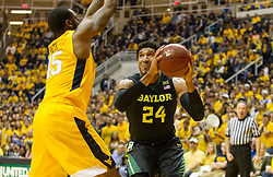 Feb 6, 2016; Morgantown, WV, USA; Baylor Bears guard Ishmail Wainright (24) drives against West Virginia Mountaineers forward Elijah Macon (45) during the first half at the WVU Coliseum. Mandatory Credit: Ben Queen-USA TODAY Sports