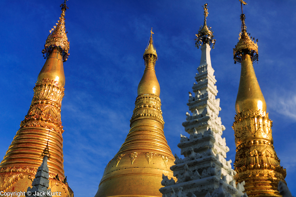 07 JUNE 2014 - YANGON, YANGON REGION, MYANMAR: The roofline of Shwedagon Pagoda in Yangon, Myanmar. Shwedagon Pagoda is officially called Shwedagon Zedi Daw and is also known as the Great Dagon Pagoda and the Golden Pagoda. It's a 99 metres (325 ft) gilded pagoda and stupa located in Yangon. It is the most sacred Buddhist pagoda in Myanmar with relics of the past four Buddhas enshrined within: the staff of Kakusandha, the water filter of Koṇāgamana, a piece of the robe of Kassapa and eight strands of hair from Gautama, the historical Buddha.   PHOTO BY JACK KURTZ