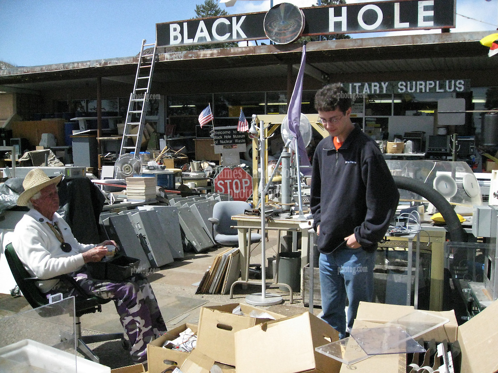 Edward B. Grothus having lunch with Pete Greeley checking out the stuff around The Black Hole Surplus Store. Los Alamos New Mexico. 22 March 2008
