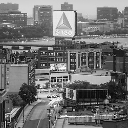 Boston skyline black and white photo with the Citgo sign, East Cambridge skyline, Fenway Park, Kenmore Square, Harvard Bridge, and the Charles River. Boston Massachusetts is a major city in the Eastern United States. Copyright ⓒ Paul Velgos with All Rights Reserved.