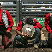 Fernando Miguel, left, prays with other bull riders prior to the competition at the Barretos na America rodeo at the Brockton Fairgrounds, Sunday,  May 24, 2009.