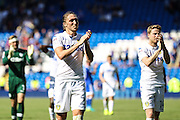 Luke Aylin of Leeds United and Eunan O'Kane of Leeds United applaud their fans after the EFL Sky Bet Championship match between Cardiff City and Leeds United at the Cardiff City Stadium, Cardiff, Wales on 17 September 2016. Photo by Andrew Lewis.
