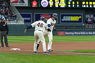 Justin Morneau #33 of the Minnesota Twins is congratulated by 3rd base coach Joe Vavra #46 after hitting a home run against the New York Mets on April 13, 2013 at Target Field in Minneapolis, Minnesota.  The Mets defeated the Twins 4 to 2.  Photo: Ben Krause