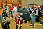 Santa Claus hold boy's hand at Cape May Christmas community art and cookie party Family activities Children,