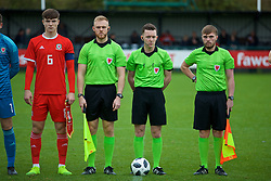 NEWPORT, WALES - Monday, October 14, 2019: Referee Jordan Harman with his assistants Ieuaqn Lewis (L) and Connor Thomas (R) with Wales' Morgan Boyes (L) before an Under-19's International Friendly match between Wales and Austria at Dragon Park. (Pic by David Rawcliffe/Propaganda)