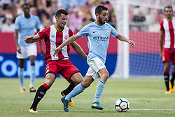 August 15, 2017 - Girona, Spain - 20 Bernardo Silva from Portugal of Manchester City defended by 15 Juanpe from Spain of Girona FC during the Costa Brava Trophy match between Girona FC and Manchester City at Estadi de Montilivi on August 15, 2017 in Girona, Spain. (Credit Image: © Xavier Bonilla/NurPhoto via ZUMA Press)