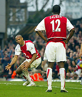 Photo: Scott Heavey.Digitalsport<br /> Arseanl v Manchester United. FA Barclaycard Premiership. 28/03/2004.<br /> Thierry Henry (L) shows his frustration at Lauren after he should have passed