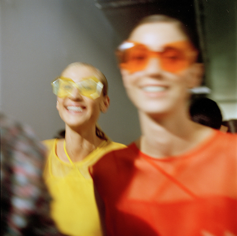 Models for the Brazilian brand, Osklen, wait for the show to begin at São Paulo Fashion Week for Summer Season 2013/2014, at Bienal, in Ibirapuera Park, São Paulo, Brazil, on Thursday, March 21, 2013.