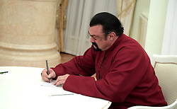 November 25, 2016 - Moscow, Russia - American actor Steven Seagal signs his new Russian passport presented him by Russian President Vladimir Putin during a visit in the Kremlin November 25, 2016 in Moscow, Russia. During the meeting Putin presented a Russian passport to Seagal making him a Russian citizen. (Credit Image: © Alexei Druzhinin/Planet Pix via ZUMA Wire)