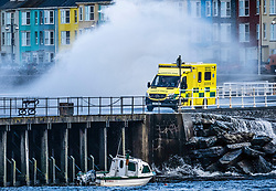 © Licensed to London News Pictures. 10/03/2019. Aberystwyth, UK. An amubulance braves gale force  westerly winds gusting at over 60mph as huge waves sweep across the Irish Sea at Aberystwyth on the Cardigan Bay coast in West Wales.<br />
