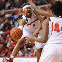 Rutgers Scarlet Knights guard Khadijah Rushdan (1) dishes a pass into the pain to Rutgers Scarlet Knights forward/center Monique Oliver (44) during first half Big East NCAA women's basketball action between Rutgers and West Virginia at the Louis Brown Rutgers Athletic Center