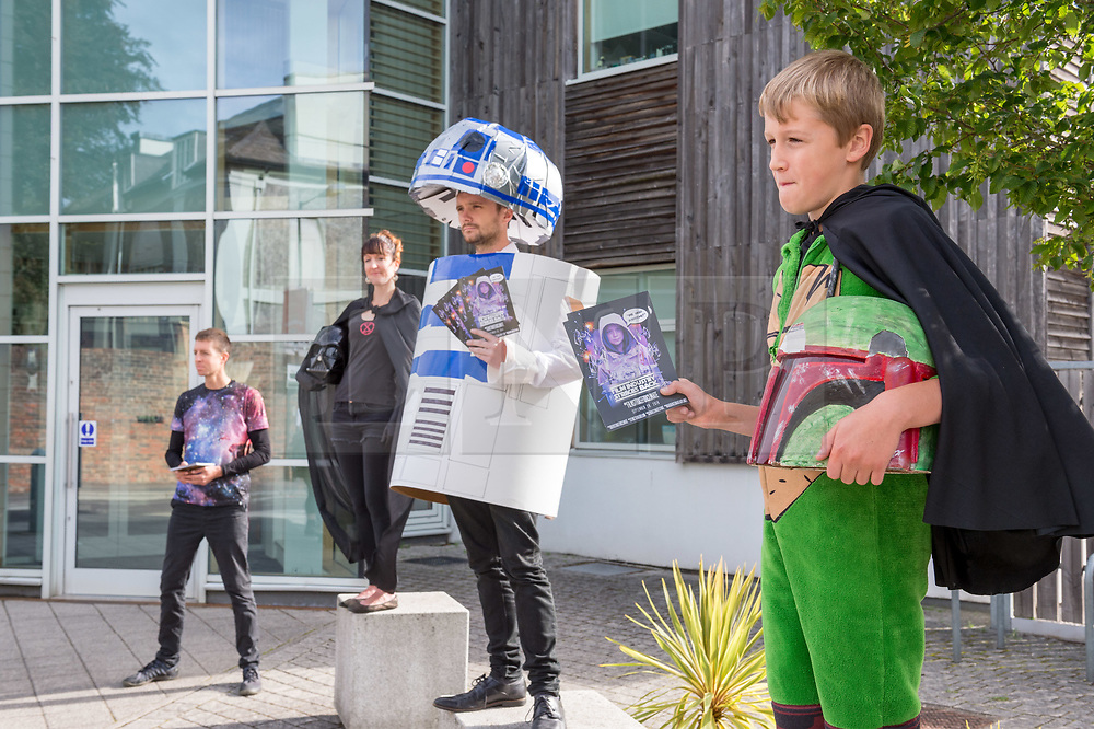 "© Licensed to London News Pictures. 30/08/2019. Bristol, UK. Campaigners dressed as characters from Star Wars hand out leaflets outside Aardman Animation Studios for the Extinction Rebellion Rebel Youth Alliance, The Film Industry Strikes Back event. Extinction Rebellion have formed an alliance with the Youth Strike for Climate and are asking the film industry for help after hearing Greta Thunberg's call ""We need everyone"" for a general strike, the Global Climate Strike on 20 September. The Rebel Youth Alliance hopes the film, television and theatre industries and its trade unions BECTU and Equity will join them and together use the industry's position as a cultural leader to press for change to avoid the collapse of civilisation and the deaths of millions. Photo credit: Simon Chapman/LNP."