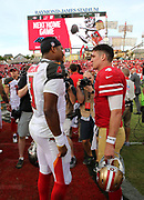 Nov 25, 2018; Tampa, FL, USA; Tampa Bay Buccaneers quarterback Jameis Winston (3) greets San Francisco 49ers quarterback Nick Mullens (4) after an NFL game at Raymond James Stadium. The Buccaneers beat the 49ers 27-9. (Steve Jacobson/Image of Sport)