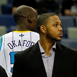 January 16, 2012; New Orleans, LA, USA; New Orleans Hornets shooting guard Eric Gordon out with a knee injury is seen by the bench during the first quarter of a game Portland Trail Blazers at the New Orleans Arena.   Mandatory Credit: Derick E. Hingle-US PRESSWIRE