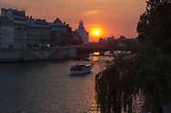 France. Paris Bateau mouche on the Saine river at sunset , in the distance , Saint louis island , ile de la cite
