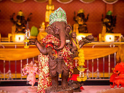 """29 SEPTEMBER 2012 - NAKORN NAYOK, THAILAND:   Statues of Ganesh at Wat Utthayan Ganesh, a temple dedicated to Ganesh in Nakorn Nayok, about three hours from Bangkok. Ganesha Chaturthi also known as Vinayaka Chaturthi, is the Hindu festival celebrated on the day of the re-birth of Lord Ganesha, the son of Shiva and Parvati. The festival, also known as Ganeshotsav (""""festival of Ganesha"""") is observed in the Hindu calendar month of Bhaadrapada, starting on the the fourth day of the waxing moon. The festival lasts for 10 days, ending on the fourteenth day of the waxing moon. Outside India, it is celebrated widely in Nepal and by Hindus in the United States, Canada, Mauritius, Singapore, Thailand, Cambodia, Burma , Fiji and Trinidad & Tobago.    PHOTO BY JACK KURTZ"""