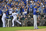 Oct 23, 2015; Kansas City, MO, USA; Toronto Blue Jays starting pitcher David Price (right) reacts after giving up a solo home run to Kansas City Royals third baseman Mike Moustakas (8) in the second inning in game six of the ALCS at Kauffman Stadium.