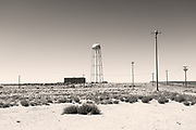 I was fascinated by the strangely sculptural but definitely incongruous water towers dotted across the New Mexico landscape. Literally in the middle of nowhere with hundreds of acres of nothingness around, these structures stick up out of the flat plains.  <br /><br />This one, just off the historic Route 66 really caught my eye, so we detoured to get to it, finding ourselves at the gates of the Albuquerque Detention Centre! As numerous B&W Sheriff cars drove past I was super anxious about being detained myself, for taking pictures there, but I genuinely was just interested in the water tower. They must have thought I was more weird than dangerous, so left me to it :-)