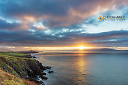 Sunrise over Dingle Bay as fishing boats heads out in County Kerry, Dingle, Ireland