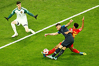 SAINT PETERSBURG, RUSSIA - JULY 10: Olivier Giroud (C) of France national team shoots on goal as Thibaut Courtois (L) and Moussa Dembele of Belgium national team defend during the 2018 FIFA World Cup Russia Semi Final match between France and Belgium at Saint Petersburg Stadium on July 10, 2018 in Saint Petersburg, Russia. MB Media