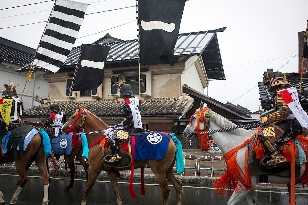 """MINAMISOMA, JAPAN - JULY 24 :  A samurai horsemen is seen in the street during """"Hon Matsuri"""" parade, Soma Nomaoi festival at Minamisoma city on Sunday, July 24, 2016 in Fukushima Prefecture, Japan. """"Soma-Nomaoi"""" is a three day traditional festival that recreates a samurai battle scene from more than 1,000 years ago. The festival has gathered more than thousands visitors as Fukushima still continues to recovery from the 2011 nuclear disaster, the samurai warriors battles for recovery of the area. (Photo: Richard Atrero de Guzman/NURPhoto)"""
