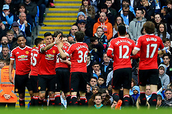 Marcus Rashford of Manchester United celebrates after scoring his sides first goal  - Mandatory byline: Matt McNulty/JMP - 20/03/2016 - FOOTBALL - Etihad Stadium - Manchester, England - Manchester City v Manchester United - Barclays Premier League