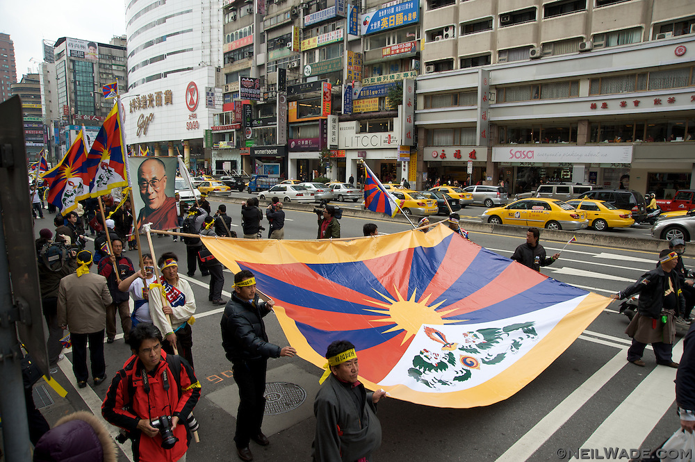 A giant Tibetan Flag and portrait of the Dali Lama are marched through the streets of Taipei, Taiwan to show support for the Free Tibet movement.