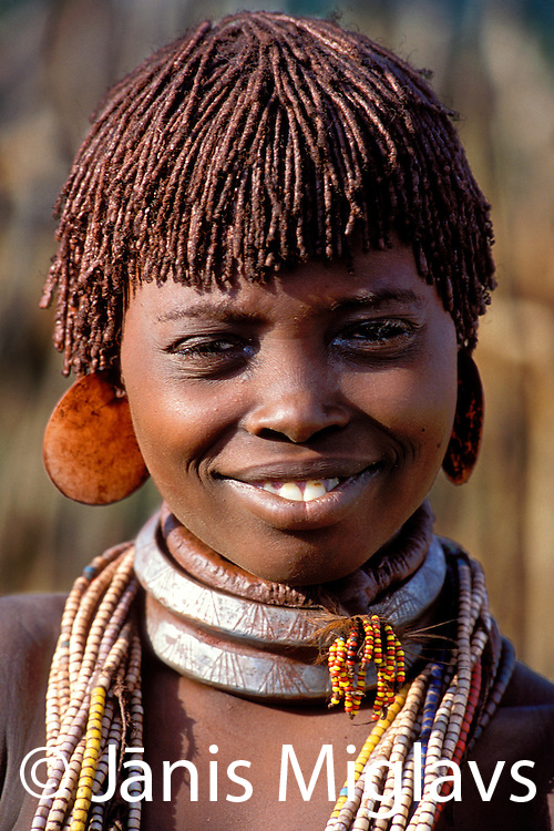 A happy Hamar woman in her village in the Omo region of Ethiopia, Africa.