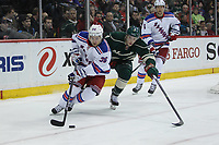 March 13, 2014 Rangers forward Mats Zuccarello (36) brings the puck out of the zone while Wild forward Charlie Coyle (3) gives chase during the second period at the Minnesota Wild game versus New York Rangers at Excel Energy Center in St. Paul MN. NHL Eishockey Herren USA MAR 13 Rangers at Wild <br />