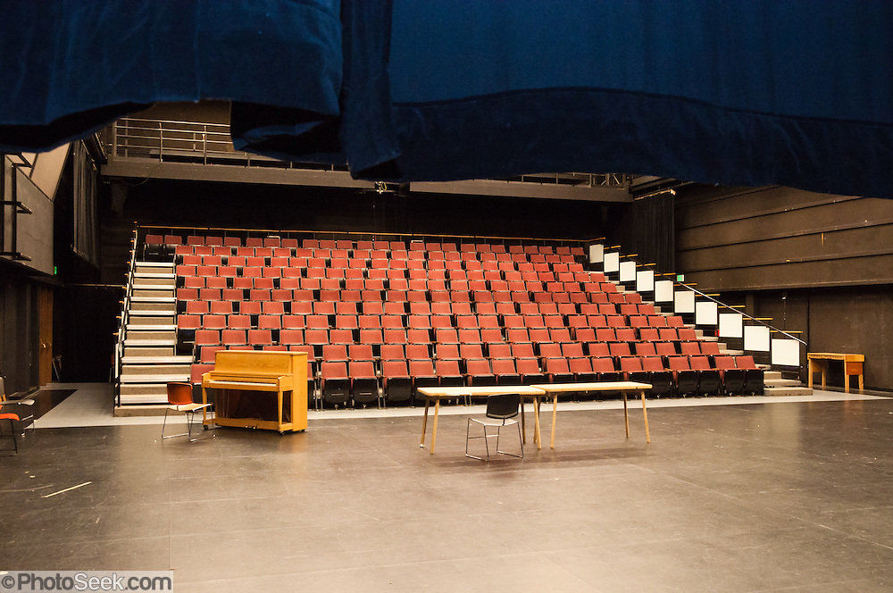 Piano, tables, empty chairs at Meany Studio Theater, University of Washington, Seattle, Washington