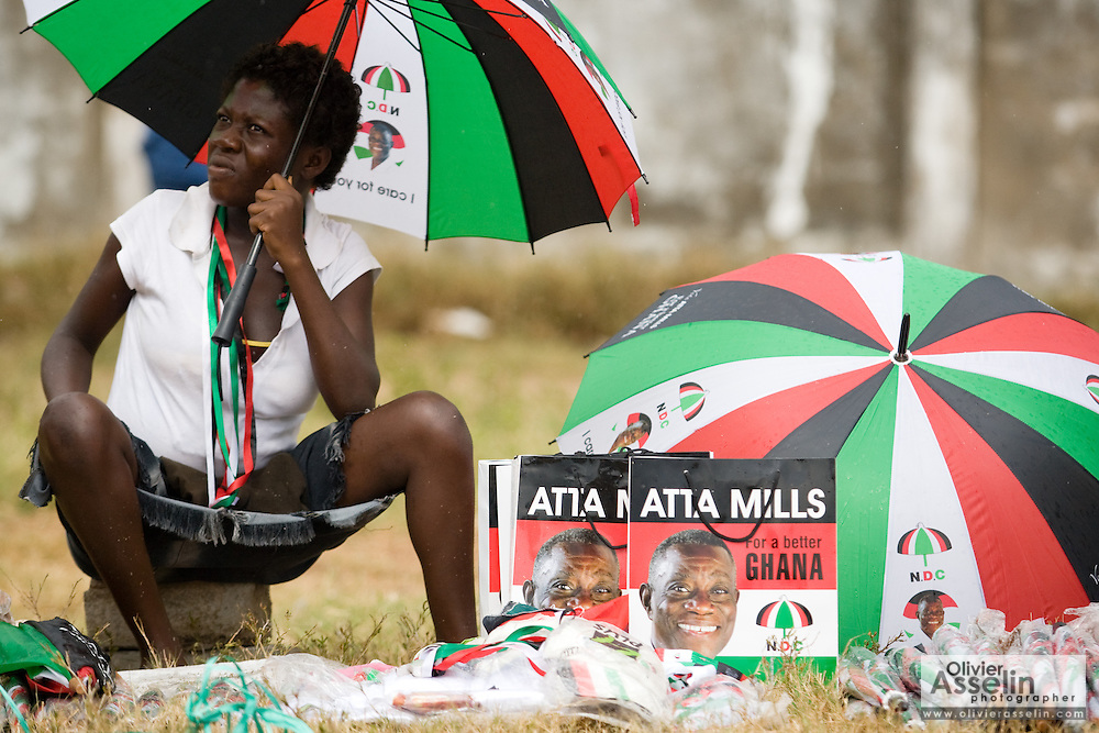 A woman tries to sell items in the colors of the National Democratic Congress (NDC), Ghana's official opposition party, during a rally in Tema, roughly 30km east of Ghana's capital Accra on Friday December 5, 2008. Ghanaians are voting in a presidential election on December 7 as incumbent John Agyekum Kufuor, leader of the New Patriotic Party (NPP),  is to step down after ruling for 2 consecutive 4-year terms.