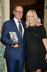 RICHARD DESMOND and his wife JOY at a party to celebrate the publication of Right or Wrong: The Memoirs of Lord Bell held at Mark's Club, Charles Street, London on 16th October 2014.